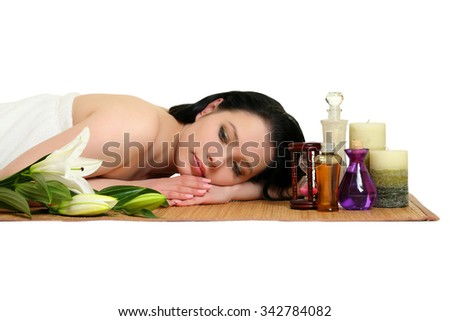 A beautiful young woman relaxing. Spa on a white background - stock photo