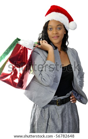 A beautiful young woman wearing a Santa hat - stock photo