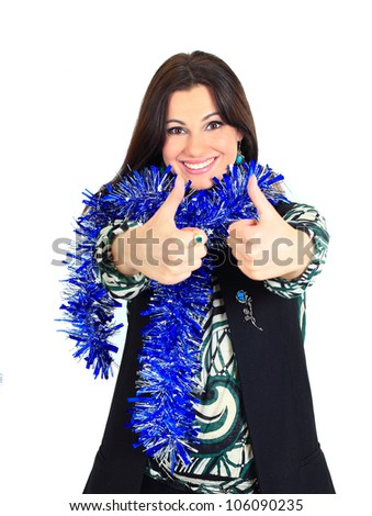 A beautiful young woman with new year decorations, on a white background, pointing his thumb up.