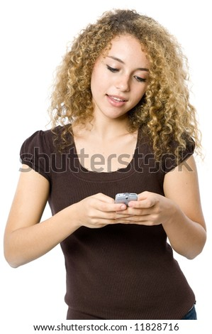 A beautiful young women texting or sms'ing on her mobile phone - stock photo