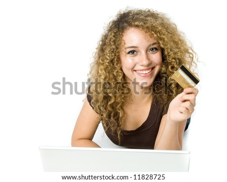A beautiful young women using a credit card and a computer to shop online