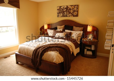 A beautifully decorated master bedroom - stock photo