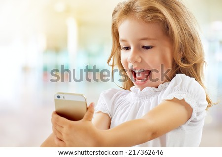a beauty child taking selfie - stock photo
