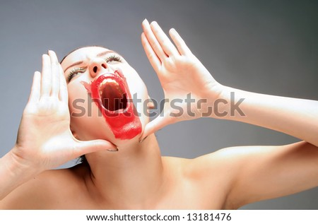 a beauty female with red lips is screaming