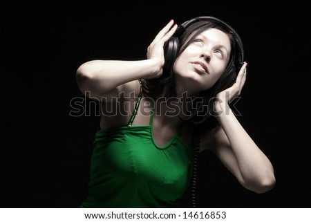 a beauty girl enjoying and listening the music - stock photo
