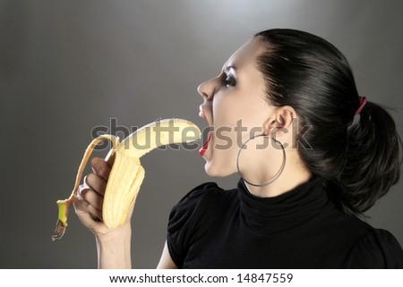 a beauty girl is eating banana - stock photo