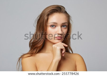 A beauty girl, on gray background - stock photo