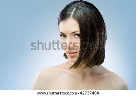 a beauty girl on the blue background - stock photo