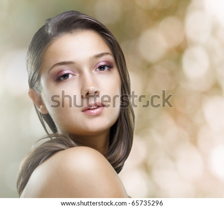 a beauty girl on the blur background - stock photo