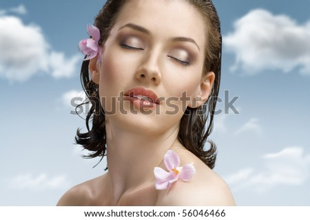 a beauty girl on the sky background