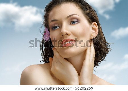 a beauty girl on the sky background - stock photo