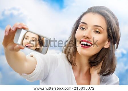 a beauty girl taking selfie - stock photo