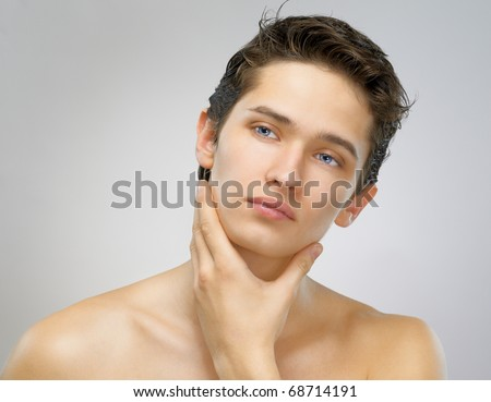 a beauty man on the grey background - stock photo