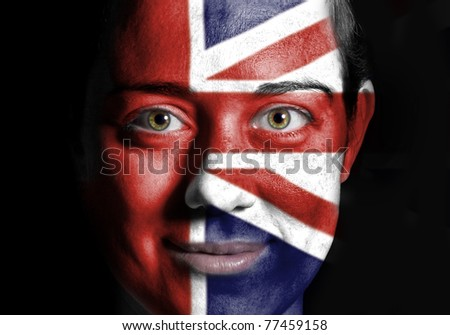 A beauty woman with the Flag of UK painted on her face