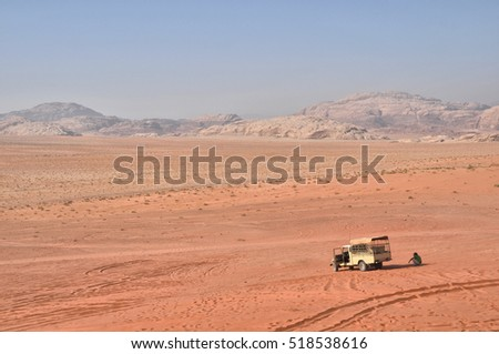 A bedouin and his old vehicle in the vast Wadi Rum desert in Jordan, in the Middle East.