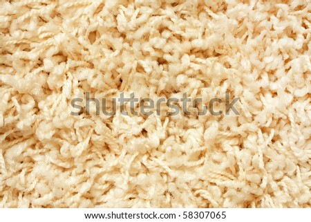 A beige carpet texture, close-up - stock photo