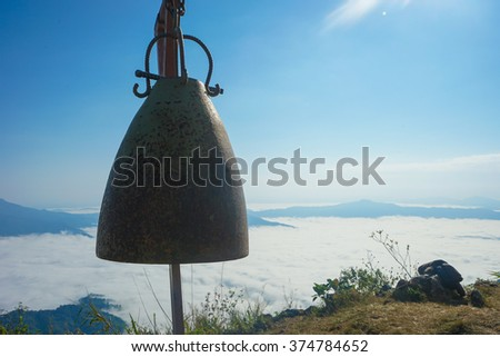A bell on Pha Tang's viewpoint. (Close-up),(Selective focus on bell) - stock photo