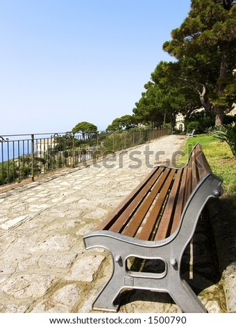 A bench in a public park on summer - stock photo