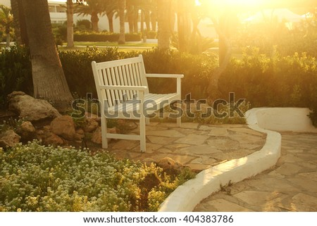 a bench in the park - stock photo