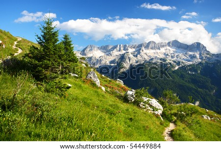 A beutiful landscape in the mountains. A footpath for mountaineers and hikers with a beautiful view over the summits of the Alps. - stock photo