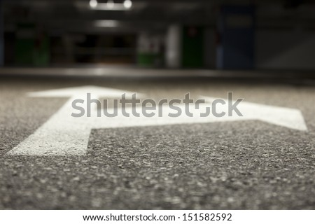 A bi-directional arrow symbol. From the ground level. Shallow depth of field. - stock photo