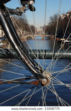 A bicycle on a canal bridge in Amsterdam