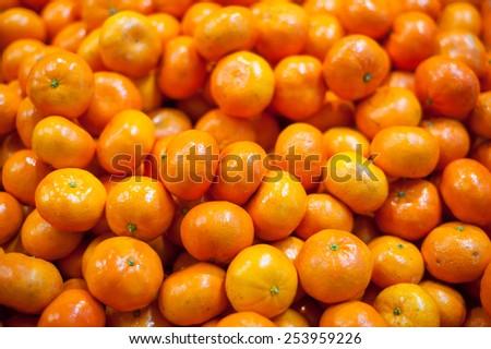 A big bunch of fresh juicy healthy mandarin oranges on fruit market as background image - stock photo