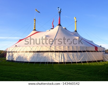 a big circus tent on a beautiful sunny day - stock photo