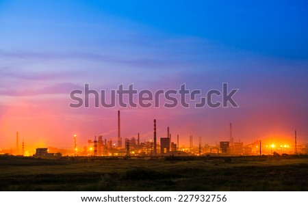 A big fire burning in a industrial buildings. - stock photo