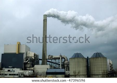 A big garbage incinerator with smoke. - stock photo