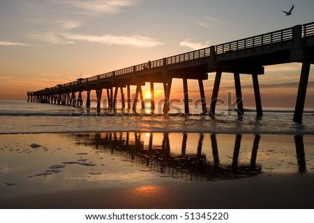 A Big Long Fishing Pier at Sunrise - stock photo