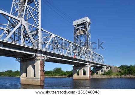 a big metal bridge through the river Volga, Russia - stock photo