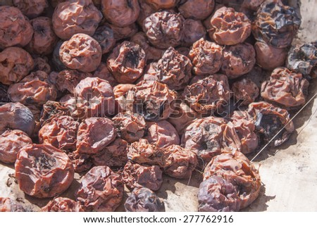 A big pile of brown, rotten apples - stock photo