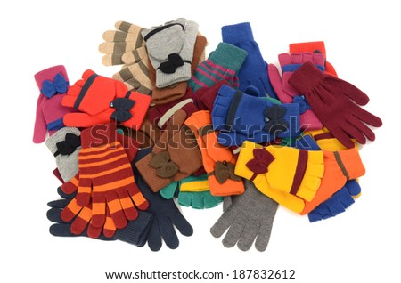 A big pile of gloves and mittens. Winter accessories isolated on white background.