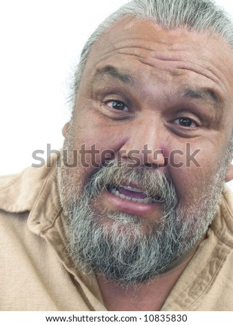 A big surprised and smiley Hispanic man