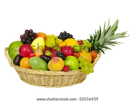 A big variety of exotic fruits in a basket - stock photo