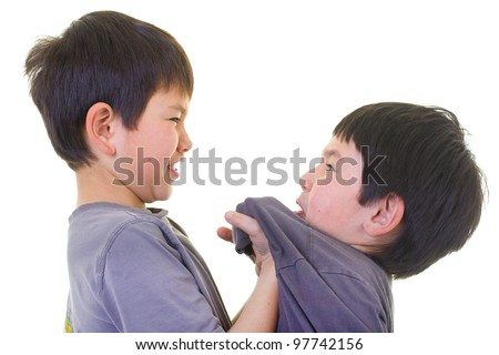 A bigger boy bullying a smaller bay - stock photo