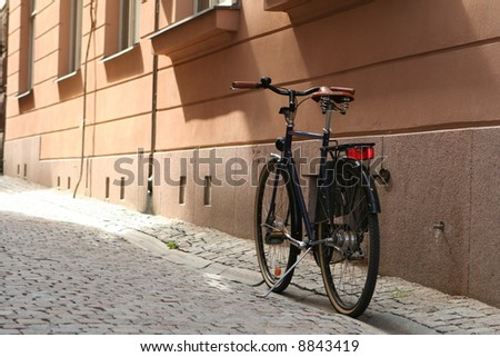 A bike in an alley in Stockholm, Sweden - stock photo