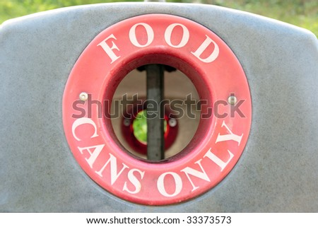 a bin for recycling food cans only - stock photo