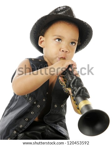 A biracial preschooler playing a clarinet in a sparkly black fedora and black leather vest.  On a white background. - stock photo