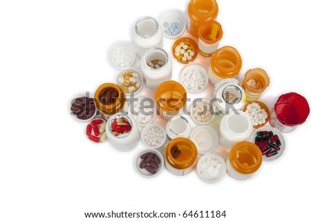 A bird's eye view of multiple medicine bottles and pills - stock photo