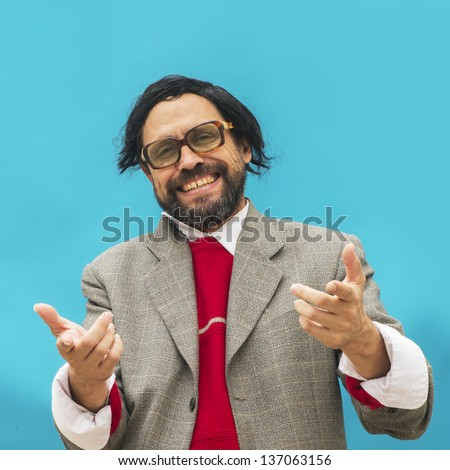 A bizarre man laughing and pointing at the camera - stock photo