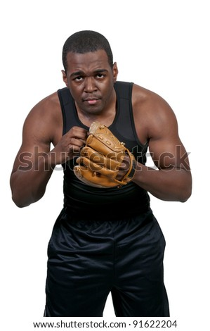 A black African American man baseball pitcher getting ready to throw a ball in a game - stock photo