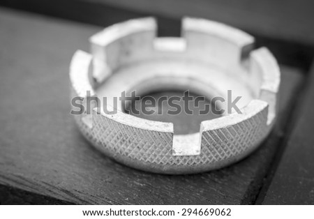 A black and white image of a bicycle spoke key tool - stock photo