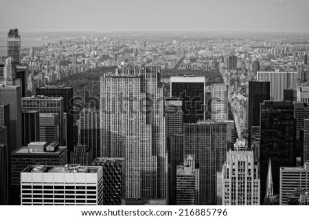 A black and white image of New York City taken from above overlooking Central Park.