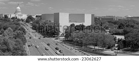 A black and white panorama of the US Capitol building at the end of Pennsylvania Avenue in Washington, DC. - stock photo