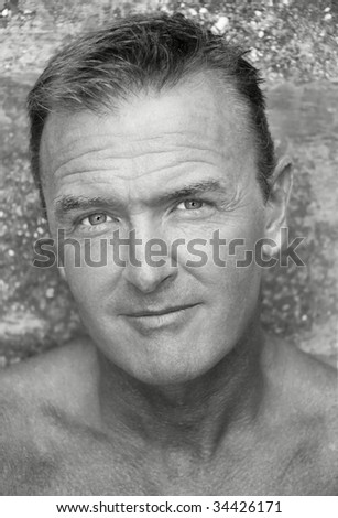 A black and white portrait of a handsome sexy forties man.