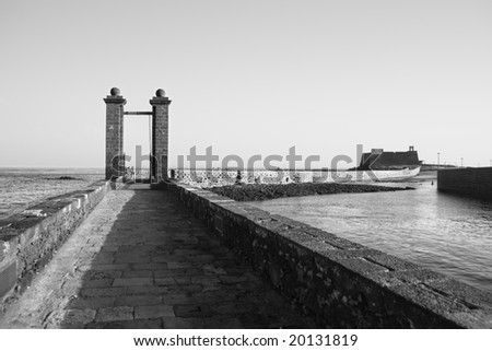 a black and white scenic view of a bridge and a castle. bucolic image. - stock photo