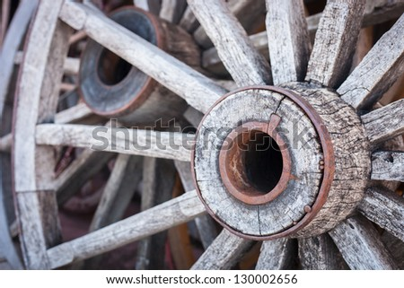 A black and white shot of a bunch of old wood wagon wheels. - stock photo