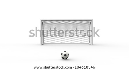 A black and white soccer ball and a goal post - stock photo